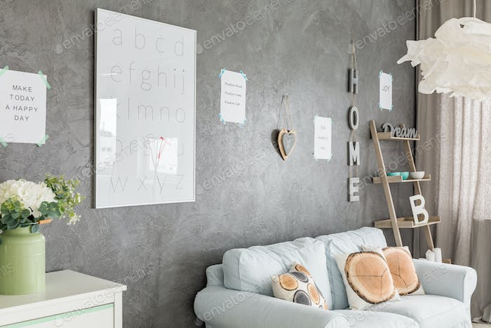 Room with grey walls and letters