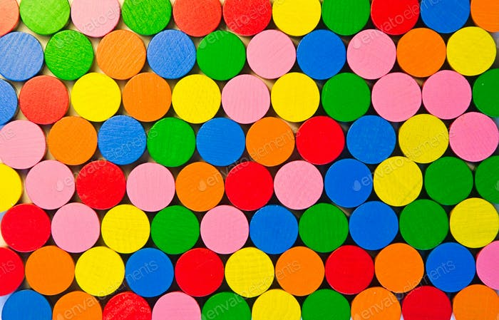 Colourful round wooden tokens