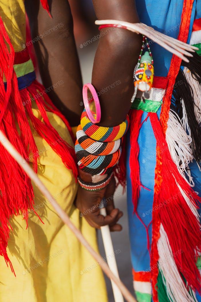close up of a turkana man wearing a traditional bead wristband