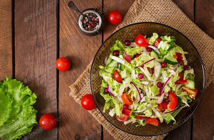 Dietary salad with fresh vegetables. Top view