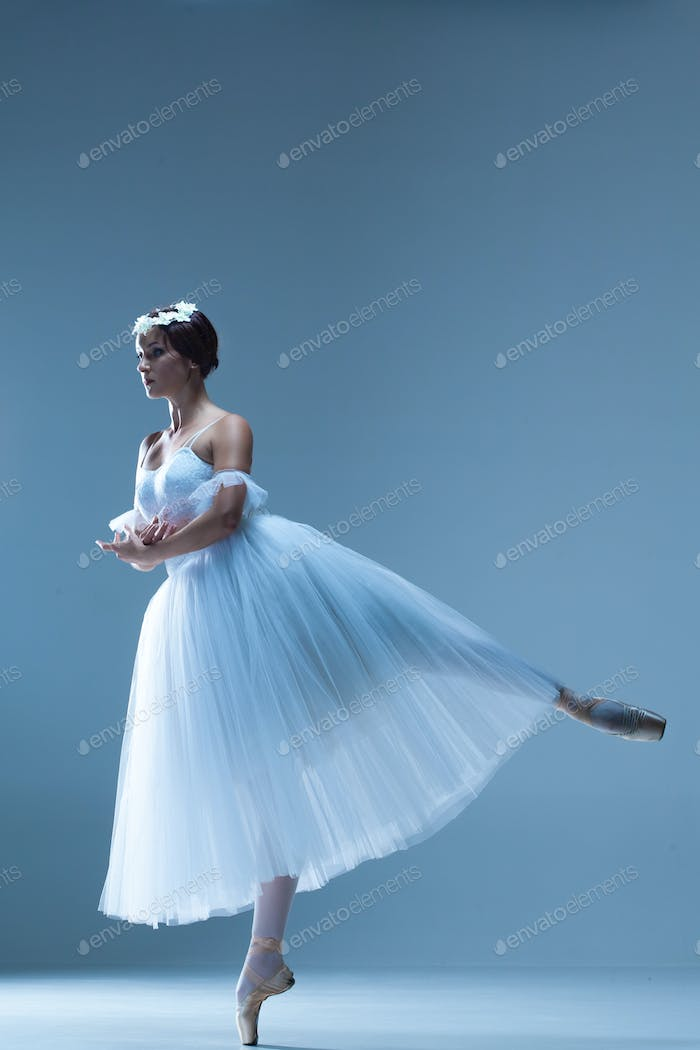 Portrait of the ballerina on blue background