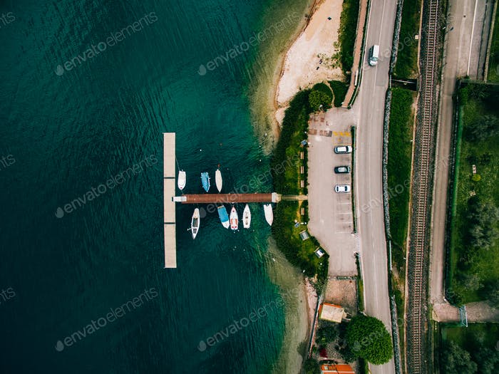 Aerial view of sea landscape with boats in marina bay in Italy.
