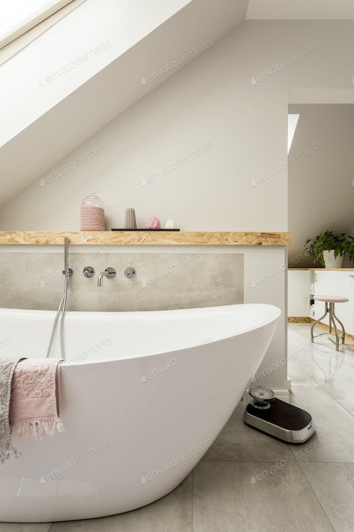 Monochromatic bathroom in attic