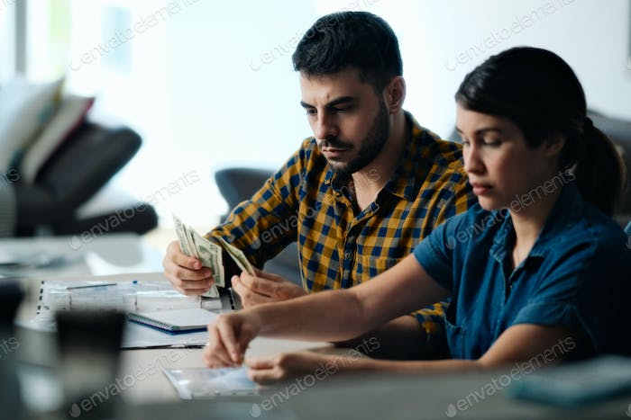 Couple Doing Home Budget And Paying Bills