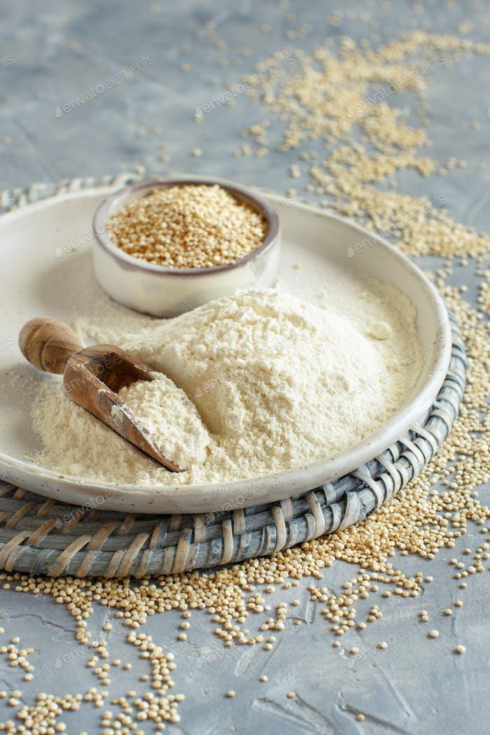 Raw white quinoa seeds and flour close up