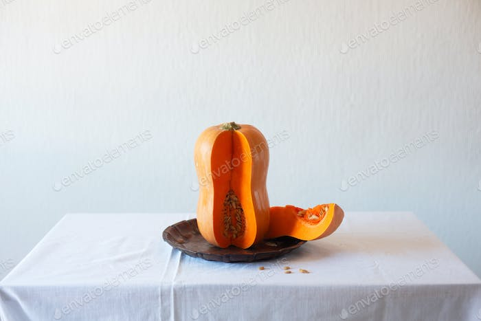 Cutted pumpkin on a white background, still life