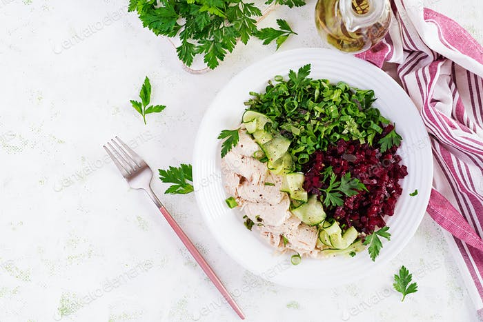 Chicken boiled fillet with salad beetroot and cucumber.