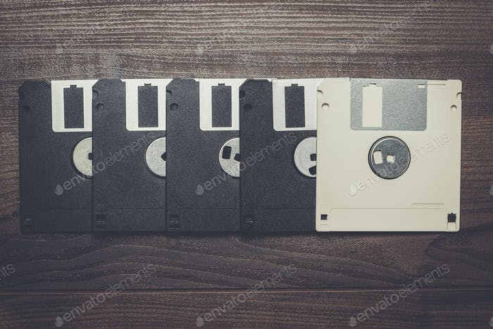 retro diskettes on wooden background