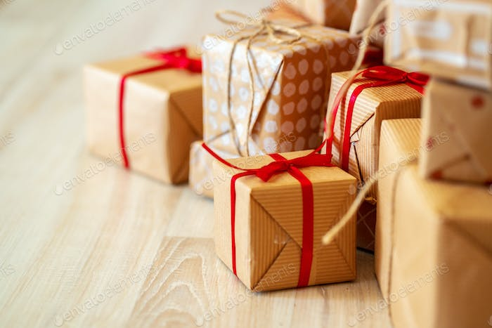 Stack of christmas gifts on beige carpet