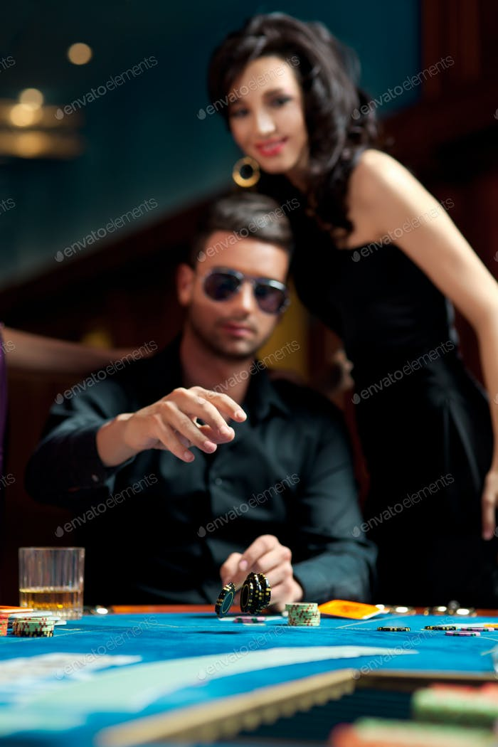 young man throwing poker chips