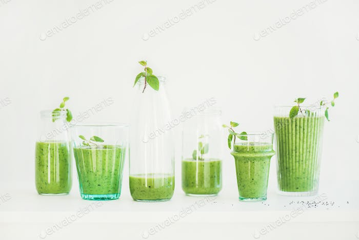 Fresh morning matcha green smoothie or juice in glasses with mint