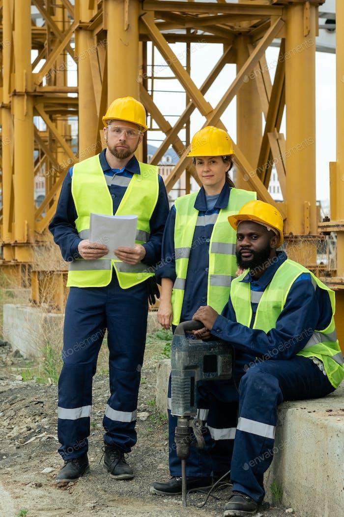 Three intercultural builders in uniform