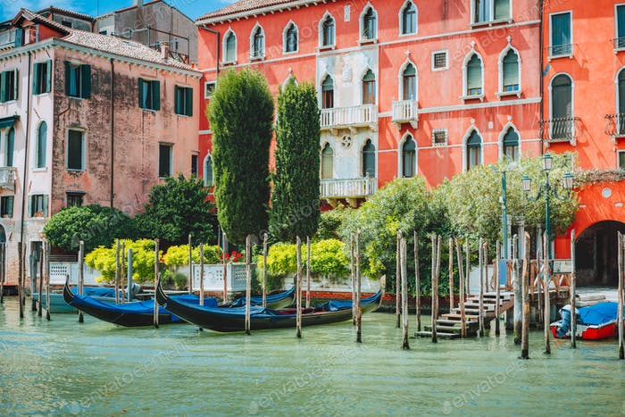 Old ancient vivid colored facades of houses on Grand Canal, Venice, Italy. Vintage hotels and