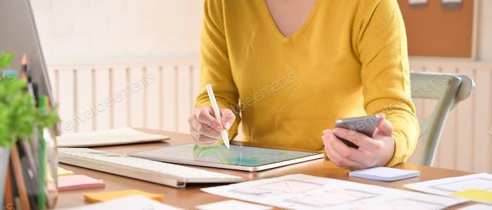 UX UI concept, A female programer working with digital tablet a software developer job.
