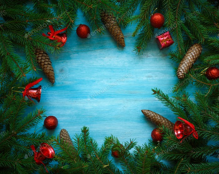 Christmas tree branches with cones and christmas decorations on