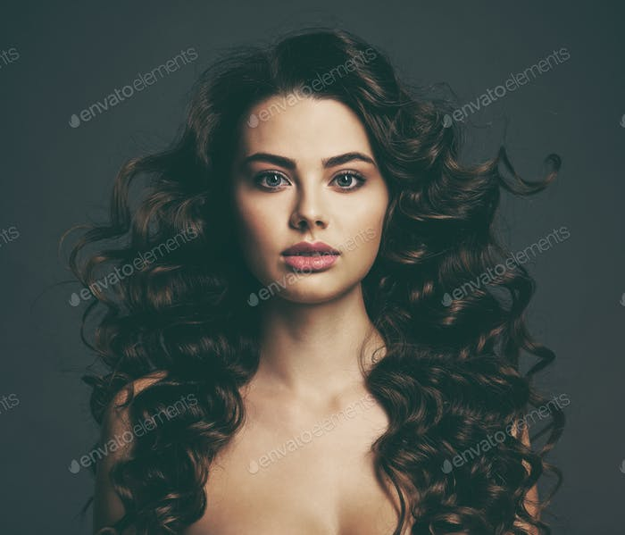 Beautiful young woman with long curly brown hair