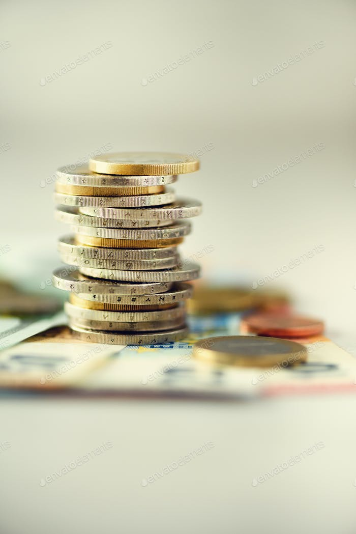 Euro money, currency. Success, wealth and poverty, poorness concept. Euro coins stack on grey