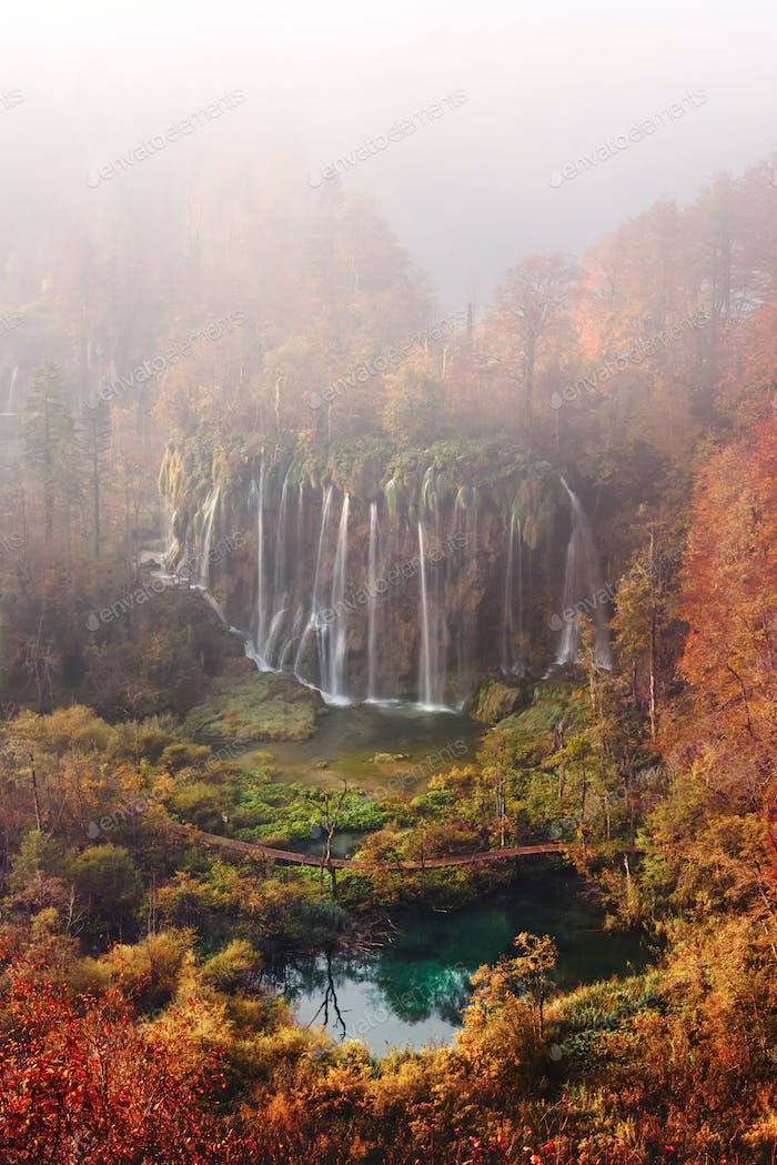 Aerial view on amazing foggy waterfall in Plitvice lakes