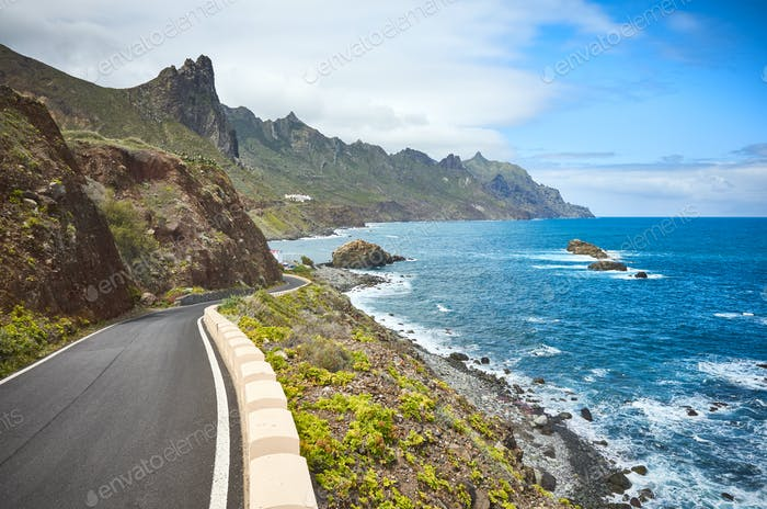 Scenic ocean drive by cliffs of the Macizo de Anaga mountain range, Tenerife.