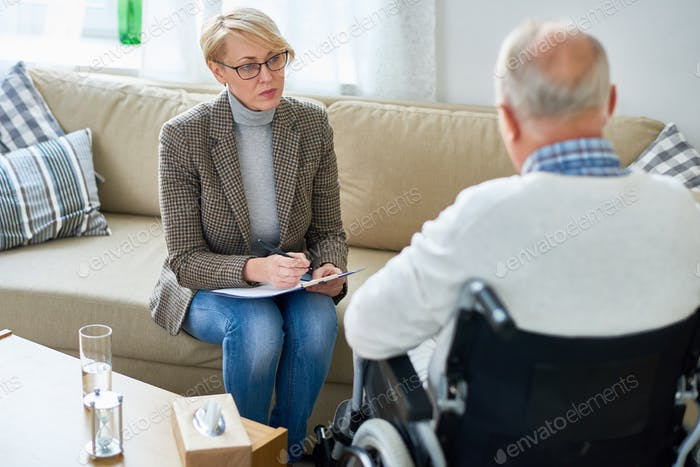 Therapist Working with Senior Patient