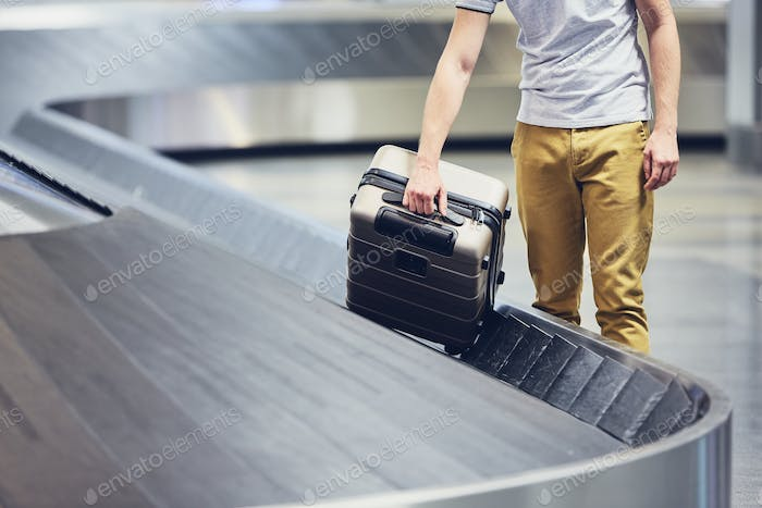 Suitcase on baggage claim