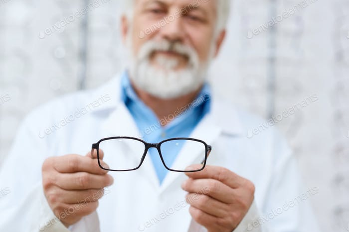 Expirienced doctor advising eyeglasses