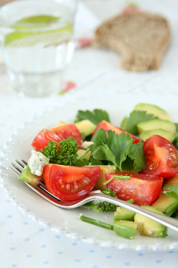 Fresh salad with avocado, tomato and cheese