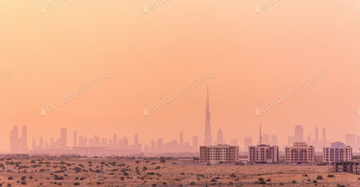 Hazy sky over city in desert