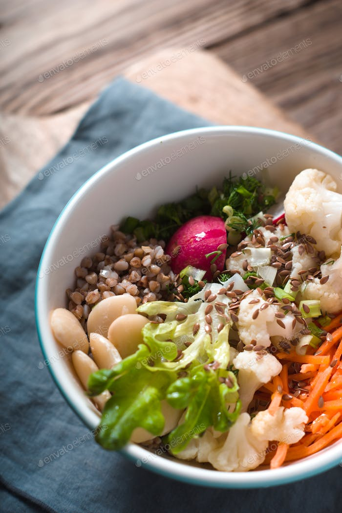 Vegetable salad with buckwheat in a ceramic bowl