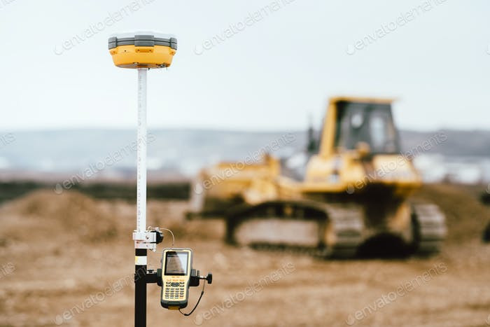 Surveyor equipment GPS system outdoors at highway construction site
