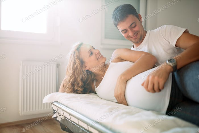 Happy pregnant woman relaxing with her husband