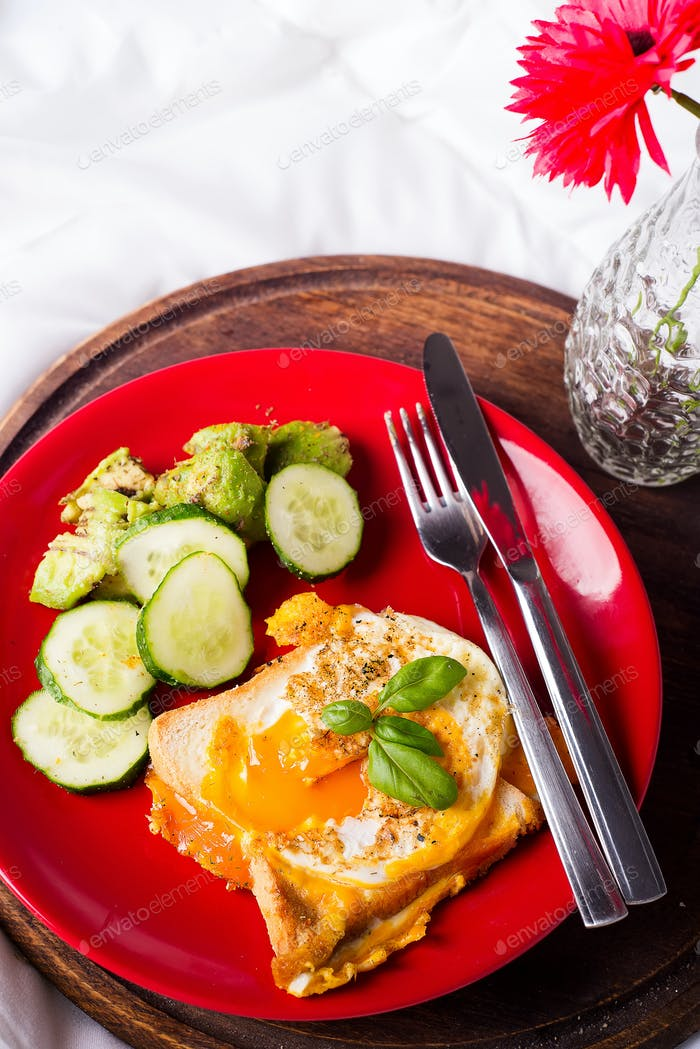 Healthy breakfast served to bed with flowers