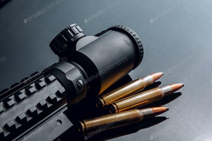 Optical scope for rifle on black background