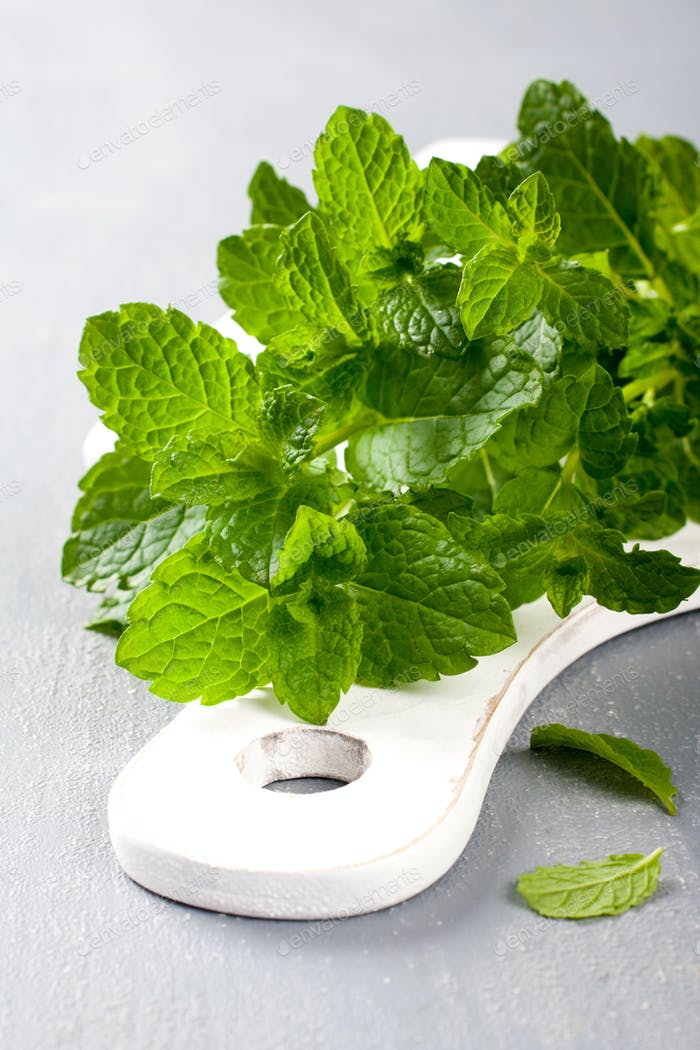 Fresh mint on white cutting board