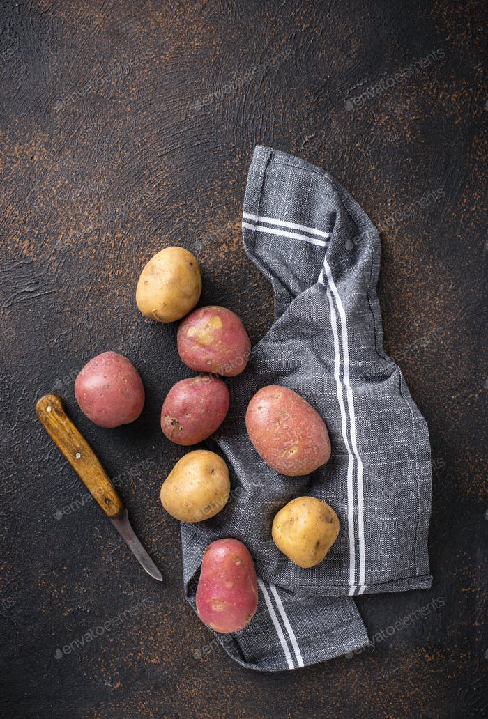 Various sorts of raw organic potatoes