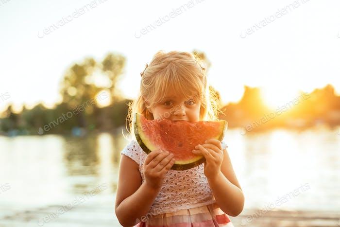 Grabbing a slice of watermelon