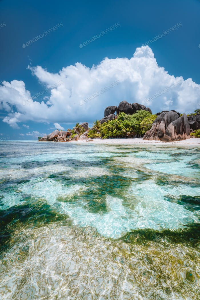 La Digue island, Seychelles. Famous paradise beach Anse Source d'Argent with shallow blue lagoon