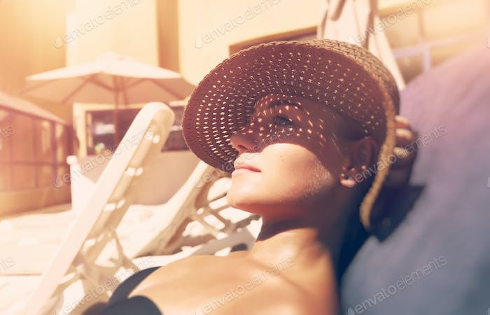 Attractive woman tanning on the beach