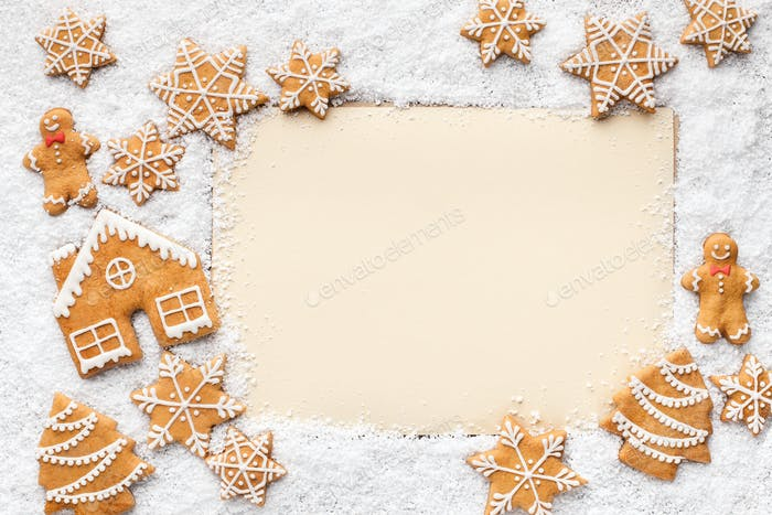 Frame of gingerbread cookies and snow with copy space