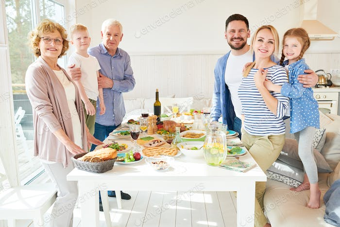 Big Family Posing at Dinner Table