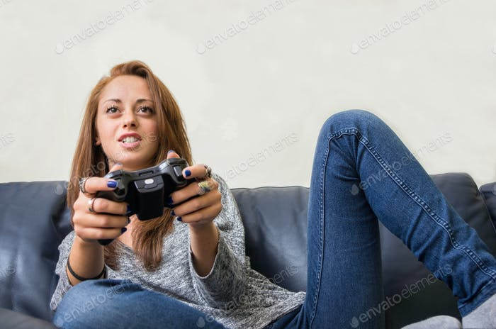 Attractive woman playing videogames.