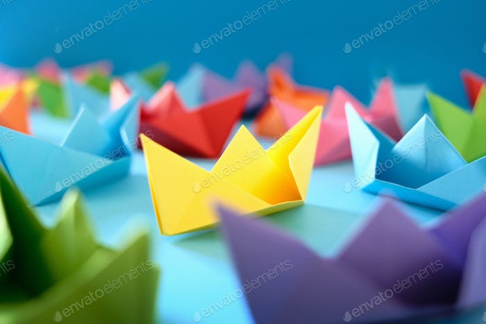 Origami Boats On Blue Background