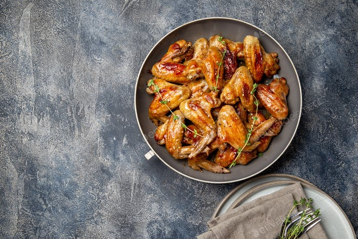Roasted chicken wings in sweet sauce. Top view copy space