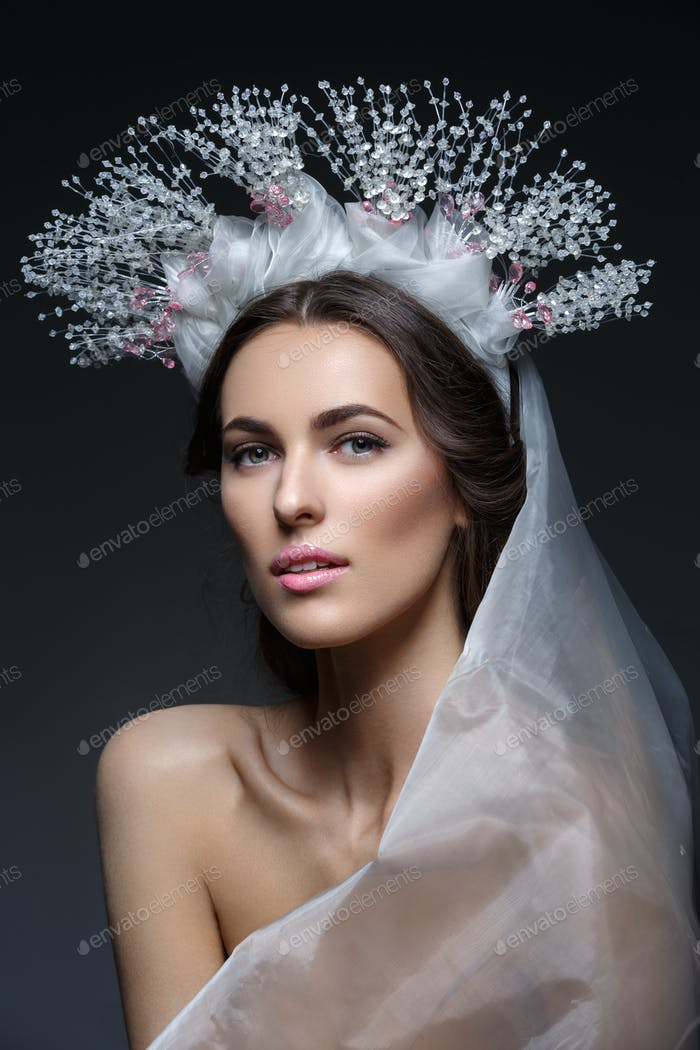 Beautiful girl in crystal crown and veil