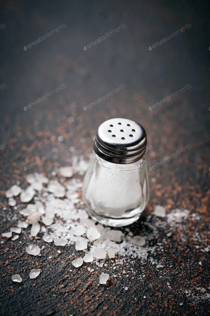 White sea salt on rusty background