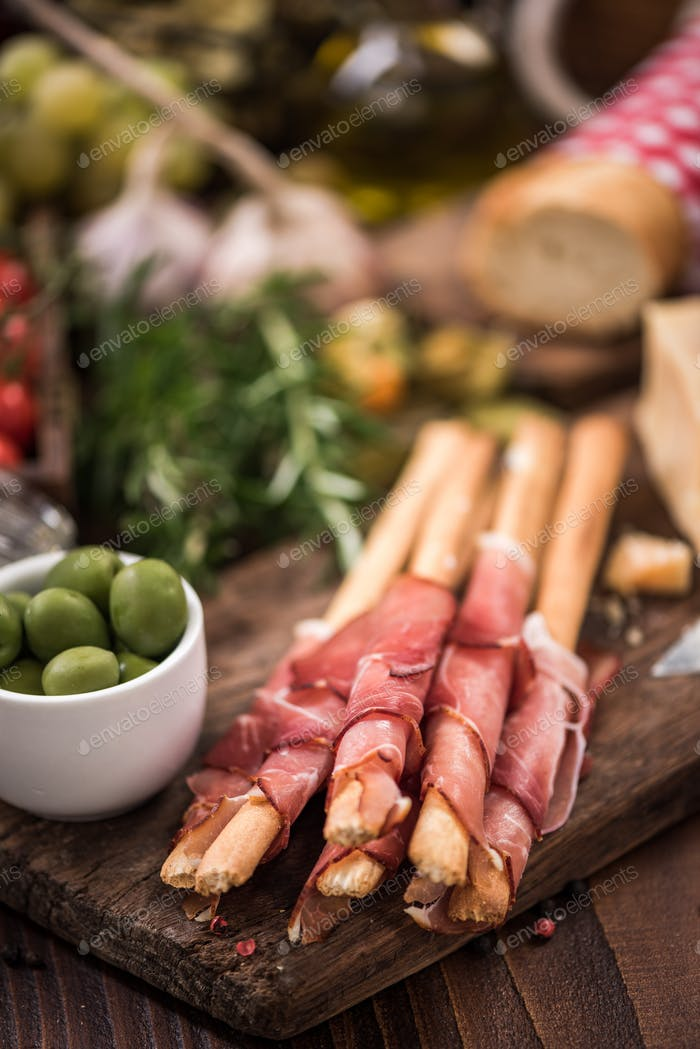 Bread sticks with prosciutto ham,italian tapa food