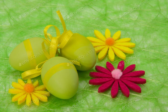 Easter background. Easter eggs and flowers.