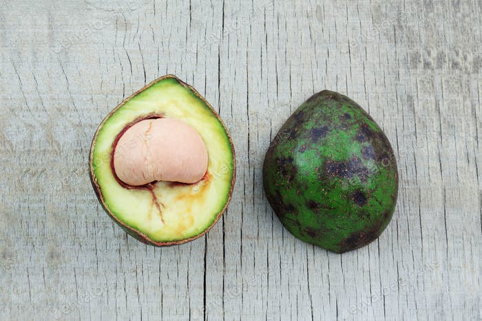 Avocado of half on wooden