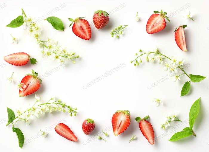 blooming bird cherry and strawberries