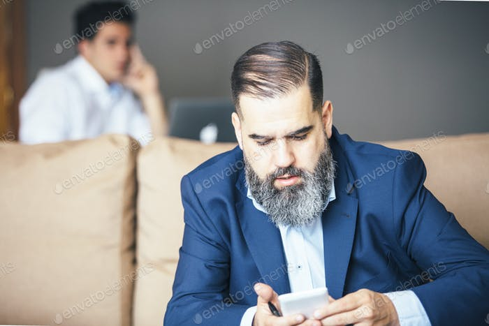 Businessman using cell